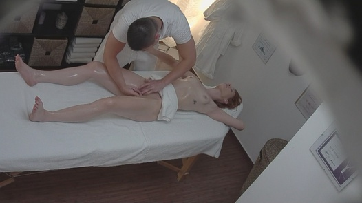 Redhead fucks the masseus