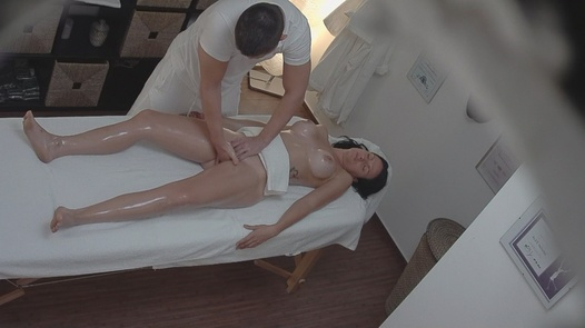 Sexy brunette fucks the masseuse