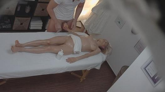 Blonde model gives the masseuse a handjob