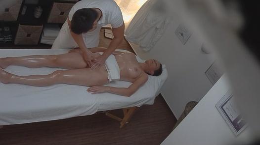 Busty brunette fucks the masseuse 2