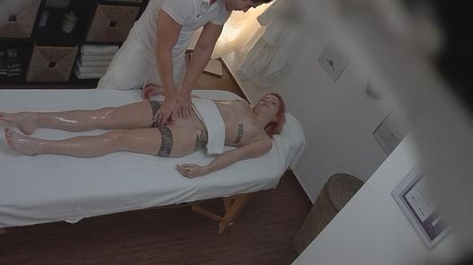 Massaging a tattooed pussy