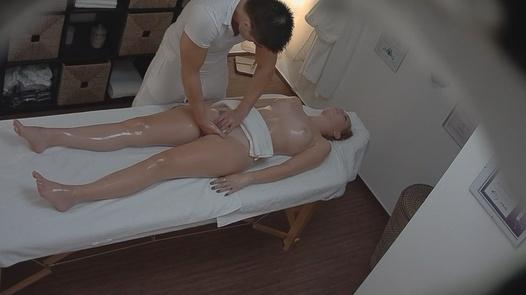 Blonde gets fingered during a massage