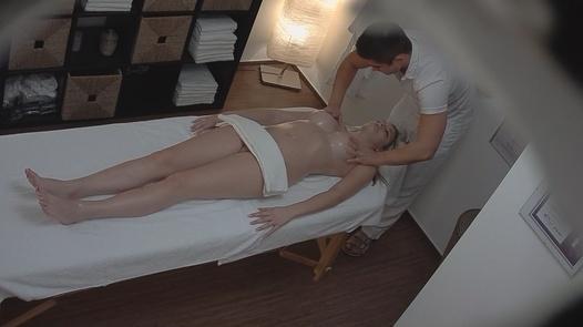 Busty 18 y/o gets an erotic massage