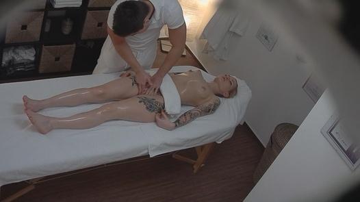 Tattooed model gets a massage