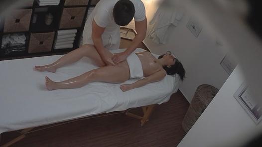 Brunette gets fingered during the massage