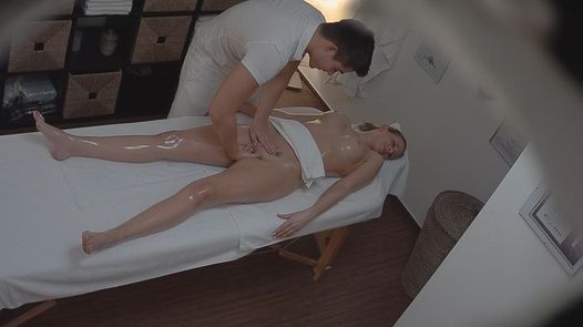 MILF gets fingered on the massage