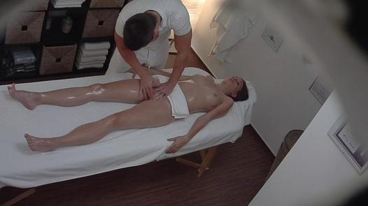 Brunette fingered during a massage