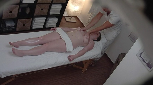 Busty redhead gets an erotic massage