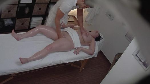 Busty chubby jerks the masseuse off