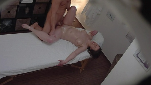 Busty brunette fucks the masseuse 5