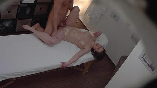 Busty brunette fucks the masseuse 5