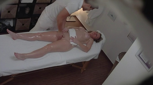 Busty MILF gets her pussy massaged
