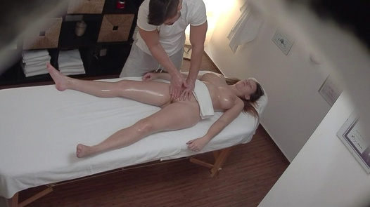 Busty brunette jerks the masseuse off