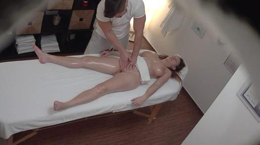 Busty brunette jerks the masseuse off