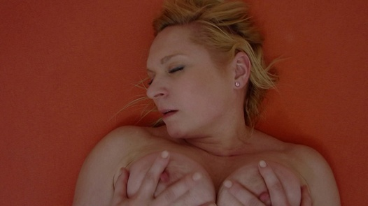 Busty MILF fingering herself