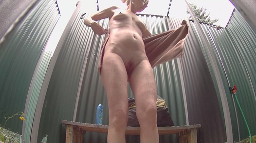 Mature blonde washes her pussy