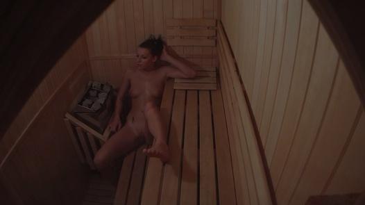 Hot model alone in sauna
