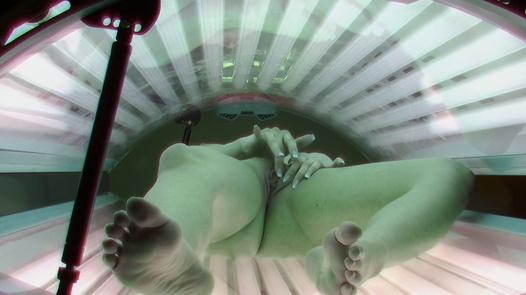 Brunette rubs her pussy in solarium