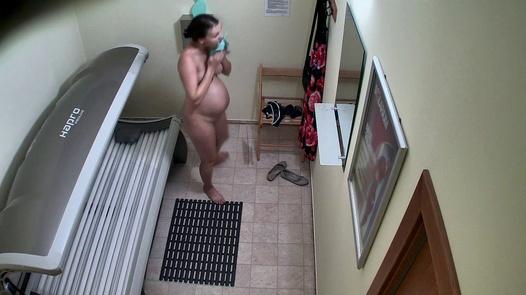 Pregnant girl in solarium 4